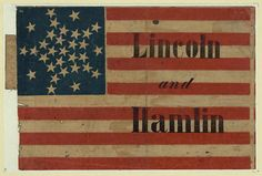"""Lincoln and Hamlin - Print shows a small campaign banner consisting of an American flag pattern, with thirty-one stars, printed on fabric. The words """"Lincoln and Hamlin"""" are overprinted in black. Collins describes a similar example, but with a slightly different placing of the overprinting. This example resembles two small flag banners produced by Howard for the Breckenridge-Lane (no. 1860-19) and Douglas-Johnson (no. 1860-20) tickets."""