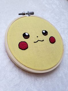 """Pikachu: This hand embroidered piece is ready to be shipped off and be in a new home. Its a perfect gift for the Pokemon trainer in your life! Embroidery Stitches Tutorial, Embroidery Monogram, Hand Embroidery Stitches, Modern Embroidery, Embroidery Hoop Art, Hand Embroidery Designs, Diy Broderie, Pikachu, Embroidered Gifts"