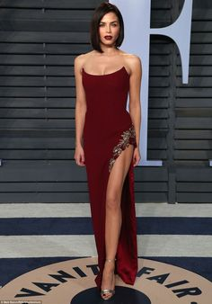 Spectacular: Jenna Dewan Tatum showed off one of her sculpted dancer's legs in a deep scar...