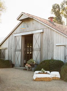 Rustic barn wedding in St Helena California. Canvas covered hay bales. Design by Alison Events. Photo Christina McNeill.