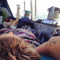 """""""I sleep on a pool mat under the stars,"""" Clark said of life aboard Swell. """"But I feel rich when I look up at that night sky and breath the fresh ocean air and leap into the sea each morning."""" 