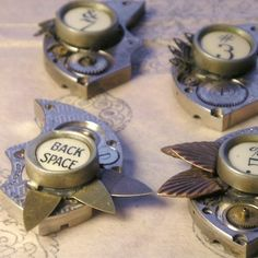 """Personalize your own romantic steampunk necklace! The photos are of a few example pieces...you can have your own created by selecting a typewriter key and then selecting whether you would like small brass leaves used (like 3), large copper leaves used (like 5) or smooth brass leaves (like Back Space)."""