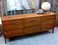 Vintage Mid Century Modern 9 Drawer Credenza Dresser by Dixie Furniture. $350.00, via Etsy.