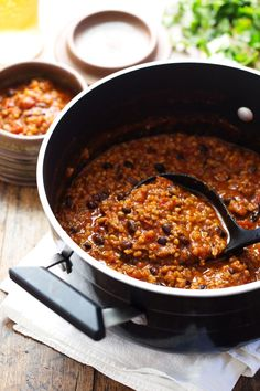Ancho Turkey Chili in a skillet with a spoon.
