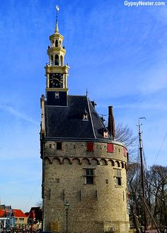 The tower of Hoorn, Holland, The Netherlands - rounded on one side to deflect cannon balls. See more: http://www.gypsynester.com/windmills.htm