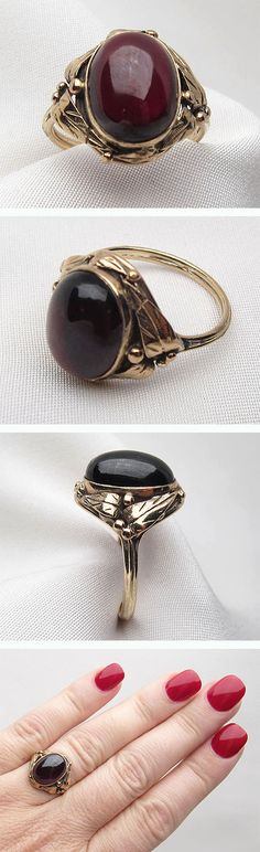 Circa 1890. This is a stunning Victorian cabochon cut garnet 15KT gold ring. With elaborate mounting of berries and leaves.