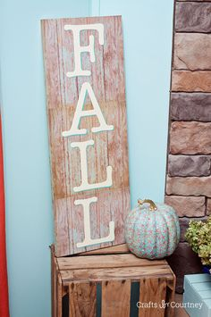 Use wood themed scrapbook paper to make this unique DIY sign for fall - so pretty and festive, you'll want to keep it up all year long! MichaelsMakers Mod Podge Rocks