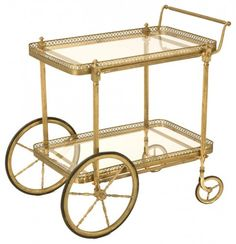 """Would you like some tea, madame?"" is what you'll soon be hearing with this vintage brass tea cart from 20th century France. It's great for serving tea, cocktails and dessert. Your guests are sure to be blown away."