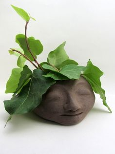 The head planters by the artist and designer Saskia Lauth are plant pots with faces. They are handmade in dark brown clay and glazed inside. Each ceramic head is a unique piece with its own special facial expression. Filled with a plant, its thoughts can grow in all directions ...