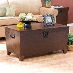 Modernize your decor with this wood trunk cocktail table. Featuring black metal handles that give it a stylish touch, this table has a lid that opens up to reveal an extra-large storage space, and its espresso stain finish enhances its aesthetic value. Trunk End Table, Sofa End Tables, Coffee Tables, Table 19, Side Tables, My Living Room, Living Room Furniture, Living Room Decor, House Furniture