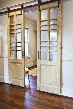 Consider replacing french doors with sliding barn doors. They make better use of the room's space and give you more options in arranging your furniture to maximize space where possible.
