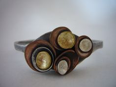 Cast Solid Sterling Silver Tako Cuff with brass copper and sterling silver details. $350.00, via Etsy.