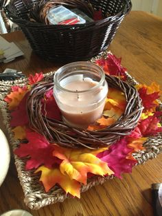 Some of my Fall decor! (Yes, I put my Fall stuff out already) it's our favorite time of year!!!! Dollar store stick wreath, bag of leafs from target and a cinnamon/pumpkin candle! :) kitchen table center piece