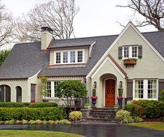 Boost your home's curb appeal with inspiration from these tips and tricks for creating perfect exterior color schemes. Learn how to figure out what exterior colors go together and how to pick hues that work for your home's style and architecture. House Exterior Color Schemes, Exterior Paint Colors, Exterior Design, Gray Exterior, Siding Colors, Cottage Exterior, Exterior Shutters, Facade Design, Style At Home