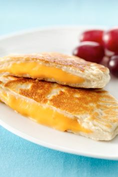 Fun new twist on grilled cheese sandwiches made with biscuits. I found these cooked better if you form them and bake them in the oven at the recommended temp rather than frying them.