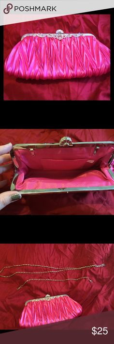 ⚡️SALE⚡️Pink Satin Evening Bag Pink pleated/rusched satin evening bag with a beautiful crystal/rhinestone design & clasp. Can be carried as a clutch or worn by using one of the two silver chain straps included (long chain: 48in, short chain: 16in). Has a small scratch on frame & small piece of fabric has come out of frame in one area (see pics) though this could easily be fixed. Used once for a wedding. I have matching peep toe pumps listed too. I think it came from David's Bridal though not…