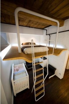 adult bunk bed thats SOOO cool for a new mom n dad n baby  I dunno, I think I would have it the other way around though..... My thoughts are, what of the platform would fall.,. I guess it's in how well it is secured, it doesn't appear to me to be attached around the wall...