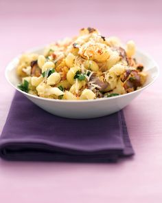 Cauliflower is roasted with red onion and garlic then tossed with corkscrew pasta and topped with toasted breadcrumbs and Parmesan cheese. It takes only 10 minutes of prep time to make this satisfying vegetarian main dish. Get the Pasta with Roasted Cauliflower, Parsley, and Breadcrumbs Recipe