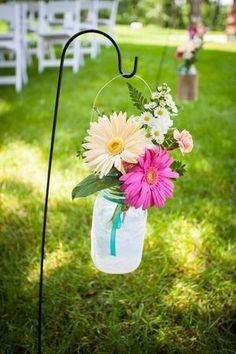 Lots of DIY Details in this Outdoor Wedding- blue mason jars- hydrangeas and baby's breath for pond