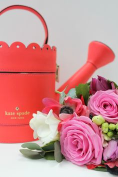 Kate-Spade-Spring-Forward-watering-can-clutch-photograhed-by-Little-Big-Bell
