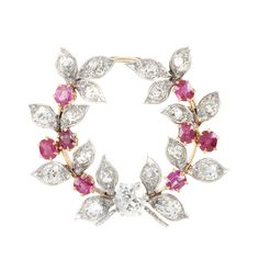 Antique Platinum, Gold, Diamond and Ruby Wreath Brooch   One old-mine cut diamond ap. .70 ct., 18 old-mine cut diamonds ap. 1.45 cts., 8 round rubies ap. 1.00 ct., c. 1905