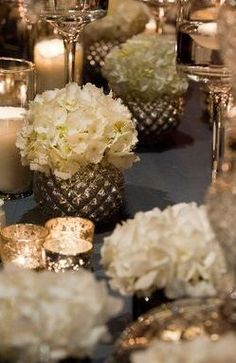 Love the varied small vases and pots - reception decor?