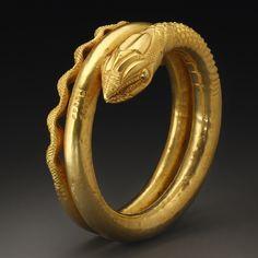 A monumental Snake Armlet      D. 10 cm. W. 295 g GoldEgypt, Roman Period, 1st cent. A.D.