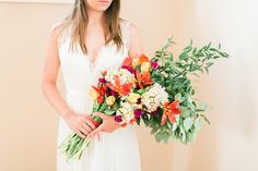 Colorful citrus inspired wedding bouquet done in presentation style