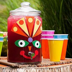 Luau Decor: Drink Dispenser - Serve Hawaiian punch from a decorated beverage dispenser. Cut tiki-like facial features from different colors of cling vinyl and stick to the front. Pour the punch into colorful kid-friendly melamine cups. Aloha Party, Hawaiian Luau Party, Moana Birthday Party, Moana Party, Tiki Party, Luau Birthday, Birthday Party Themes, Hawaiian Punch, Beach Party