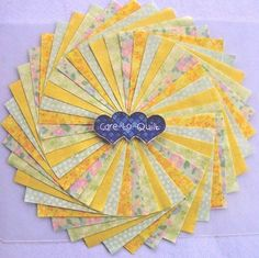 Quilting Fabric,Mint Green & Yellow  Swirl Charm pack 5 inch squares 40 per pk.