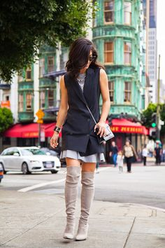 """I love vests, so I've been thinking I """"need"""" a long-line one. I don't know if I could pull this off, but this is a cute new way to wear this type of vest."""