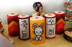 Kyle has volunteered to glue thousands of beans and candy to paper towel rolls to make a couple of these towers for Joseph's first birthday...one will say 'Yo Seb' in Korean, and one will have a tiger on the front, as 2010 was the year of the tiger!