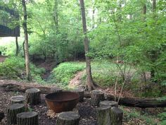 """A fire pit is the most essential part of any rustic campsite— it doesn't need to be fancy, but as the center of social activities it must be pleasing to the eye. That's why Michael in Olivette, MO chose the Big Bowl O' Zen 37 inch Sculptural Firebowl™ when he built a gathering spot at his home in the forest.  He wrote me:      """"The Bowl of Zen looks awesome in our woods. Makes a heck of a fire, too."""""""