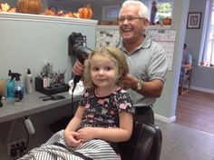 Grand father cut her hair