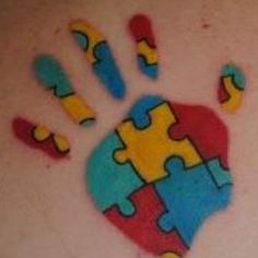Hand Print with Puzzle Pieces - Cool Puzzle Piece Tattoo Design Ideas, http://hative.com/cool-puzzle-piece-tattoo-design-ideas/,