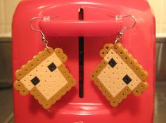 These cute little slices of toast will look adorable with any outfit! Each pair comes with rubber earring backs.    ** Earrings are Nickel Free