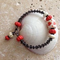 Art Jewelry Elements: Tutorial - Beaded Spiral Wire Bangle