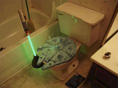 Lightsaber plunger and Millennium Falcon toilet seat cover because reasons