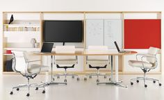 Eames Soft Pad Management Chairs  The Management chair is a low-back chair with arms.