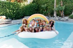 The Miller Affect and friends in Palm Springs on a rainbow funboy pool float