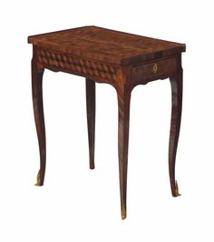 A Louis XV Tulipwood and kingwood parquetry side table c 1750