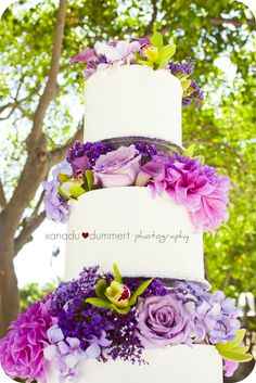 simple white wedding cake. i would do blue flowers one day!!! or pink