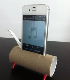 Toilet paper roll, and 4 tacks makes a iPod holder, plus spreads sound through out room! Easy DIY. A ghetto speaker!