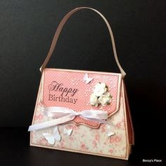 Time to get girly with this pretty handbag shaped card that also features a little pocket for money or a gift card.  If you keep the embellishments to a minimum, and change the handle to a length of r
