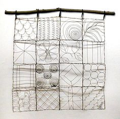Wire art.  Reminds me of a quilt.  Like the wire with the wood.