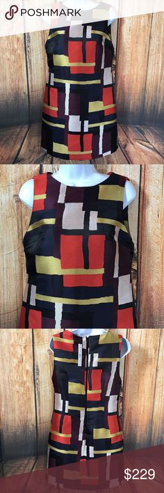 "NEW NWT Alice and Olivia Clyde A Line Shift Dress NEW NWT Alice and Olivia Clyde A Line Shift Dress Size 6 Painted Grid  Alice + Olvia  Clyde A Line Shift Dress  Graphic print all over  Tonal topstitching and panel seaming  Center back zip  Sleeveless  Lined  Color as listed on tag is ""Painted Grid"". Rich jewel tones, great fall colors!  100% polyester  Size 6  Measures 17"" across bust  Measures 33"" long from center back  NEW with tags  MSRP $348 Alice + Olivia Dresses Midi"
