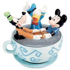 Goofy,Donald Duck and Mickey Mouse in a teacup.