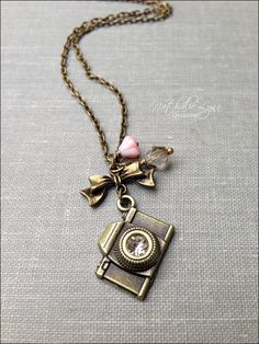 Camera Necklace, Photography Necklace, Camera Jewelry, Photography Jewelry, Photographer Gift, Vintage Camera by nathalielynndesigns on Etsy https://www.etsy.com/listing/155371502/camera-necklace-photography-necklace