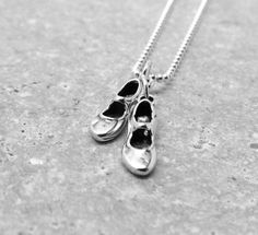 Sterling Silver Tap Dance Shoes Charm Necklace Two sterling silver tap shoe pendant hang from a sterling silver ball chain charm necklace. Finishes with an sterling silver lobster clasp. Tap shoes measure an additional Thing 1, Ballet, Tap Dance, Initial Charm, Handmade Necklaces, Handmade Jewelry, Silver Charms, Tap Shoes, Dance Shoes