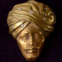 """An exquisitely detailed Victorian brooch in the form of an Arab man with a diamond studded turban. Victorians fetishized Asia, Northern Africa, and the Middle East as generically """"exotic"""" and often conflated various cultures and aesthetics. Victorian..."""